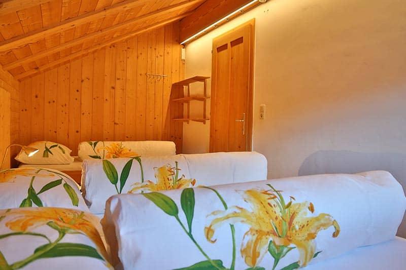 Ferienwohnung Tannberg Dreibettzimmer